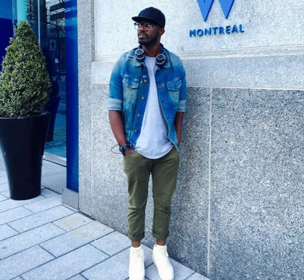Whether he's on his way to play a killer set at Coachella or simply promoting his music there's no denying that award winning DJ, Black coffee has impeccable fashion sense. Check out how this rolled up denim jacket with a grey tee, olive pants (also rolled up) and a pair of white sneakers.