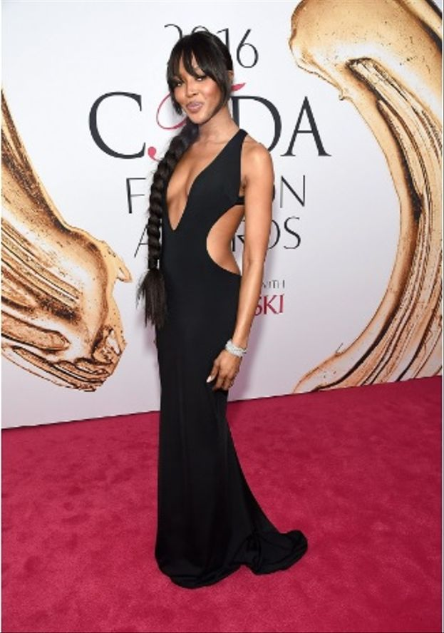 Queen of the ramps, Naomi Campbell showed that age ain't nothing but a number in a backless black number. She looked gorgeous in a cut-out dress Brandon Maxwell gown.