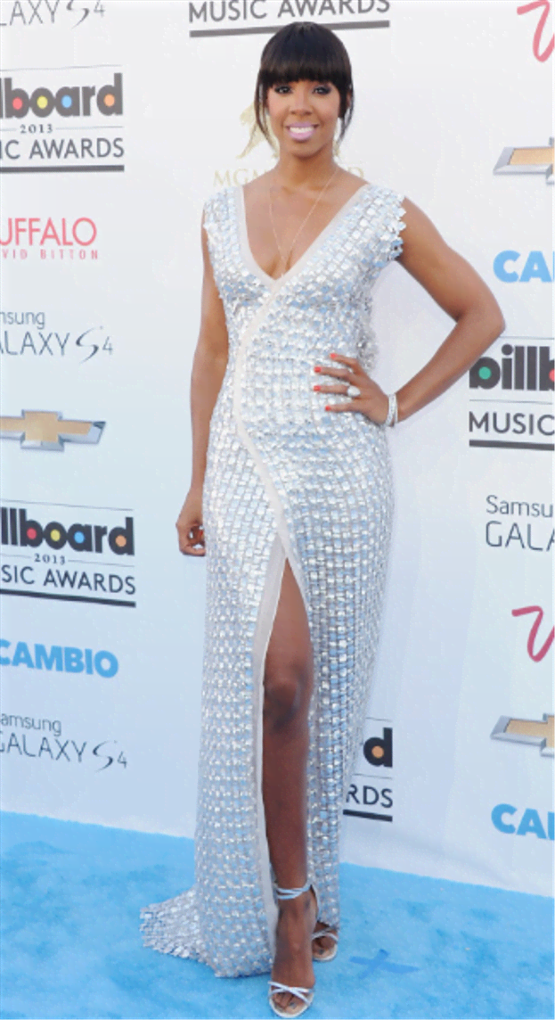 The metallic breeze was delivered to the carpet at the 2013 Billboard Awards. Kelly seems to be a fan of slits and this Rami Al Ali number paired up with white gold jewels and silver strapped sandals and of course the infamous fringe and minimal make up