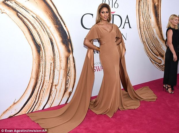 Orange is the New Black star Laverne Cox arrived in a dramatic Marc Bouwer bronze gown with flyaway cut-outs. Gorgeous!