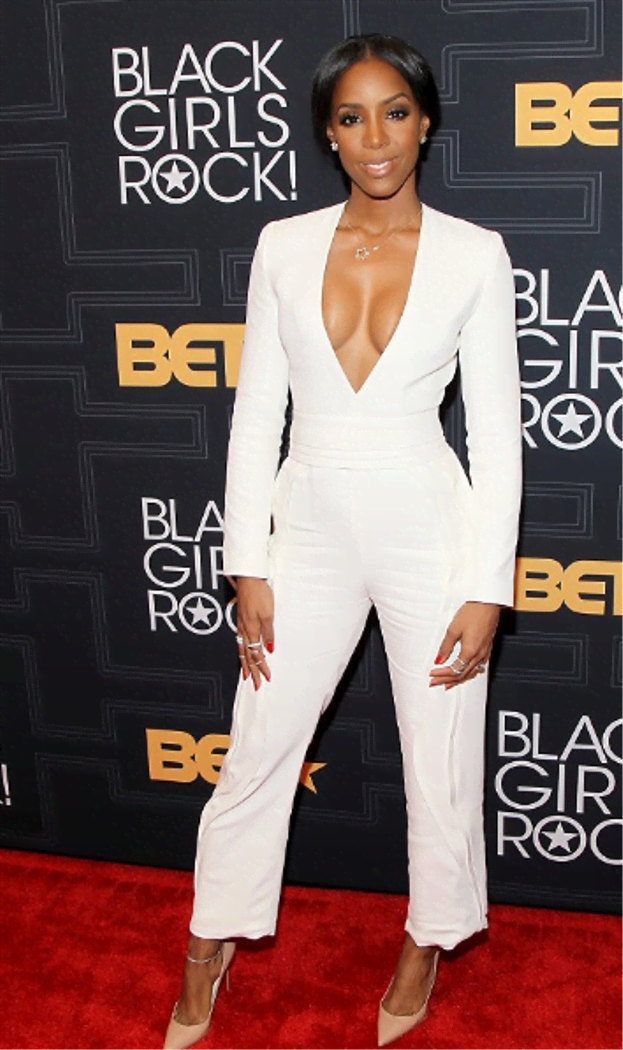 She looked incredibly angelic and all business-like at the 2016 Black Girls Rock. We are loving the plunging neckline jumpsuit which she rocked with a nude pump.