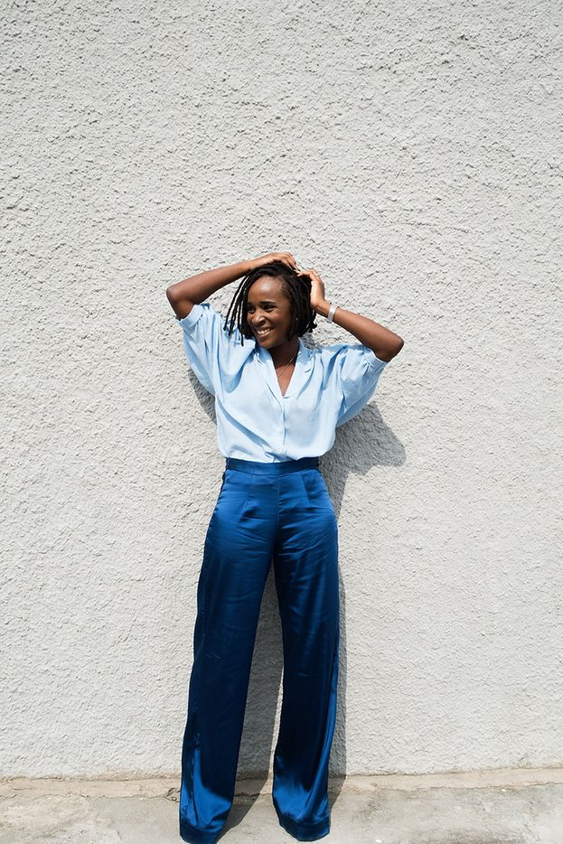 Nigerian designer Bubu Ogisi, looks like a dream in this dark blue satin wide legged pants with a pale blue shirt which is a classic look for a day out.