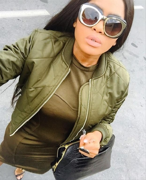 Radio presenter and DJ, Lerato Kganyago stepped out in this bomber jacket which she paired with a matching A-line dress and a pair of brown strappy sandals. Her look is both functional and stylish!