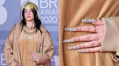 Billie Eilish ai BRIT Awards 2020 in Burberry dalla testa ai piedi, mega manicure compresa
